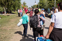 Refugees arrive to Tovarnik. TOVARNIK, CROATIA - SEPTEMBER 19: Refugees arrive in Croatia on September 19, 2015 in Tovarnik, Croatia Royalty Free Stock Photos