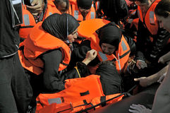 Refugees arriving in Greece in dingy boat from Turkey. LESVOS, GREECE october 12, 2015: Refugees arriving in Greece in dingy boat from Turkey. These Syrian Royalty Free Stock Image