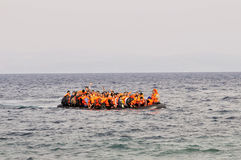 Refugees arriving in Greece in dingy boat from Turkey. LESVOS, GREECE october 20, 2015: Refugees arriving in Greece in dingy boat from Turkey. These Syrian Royalty Free Stock Image