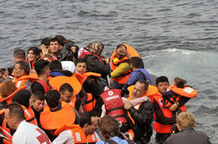 Refugees arriving in Greece in dingy boat from Turkey. LESVOS, GREECE october 20, 2015: Refugees arriving in Greece in dingy boat from Turkey. These Syrian royalty free stock photo
