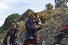 Refugees arriving on Lesvos Greece. Lesvos, Greece- October 12, 2015, 2015. Refugee migrants, arrived on Lesvos in inflatable dinghy boats, they stay in refugee royalty free stock photos