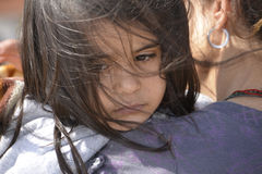 Refugees arriving at Lesvos. Mytilini, Lesvos, Greece, 03-March-2016: Refugees child arriving at Lesvos. After they flee from their home country. They travel royalty free stock photo