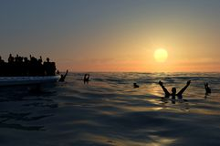 Refugees on a big rubber boat in the middle of the sea that require help. Sea with people in the water asking for help. Migrants crossing the sea vector illustration