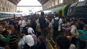Refugees in Budapest, Hungary. Crowds of refugees are trying to get on the train at  Keleti rail station in Budapest, Hungary, 2nd September 2015 Stock Photography