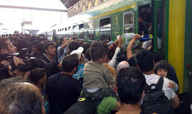 Refugees in Budapest, Hungary. Crowds of refugees are trying to get on the train at  Keleti rail station in Budapest, Hungary, 2nd September 2015 Royalty Free Stock Photos