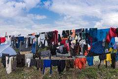 Refugees camp in Greece. Refugees and immigrants try to dry their clothes after heavy rain on March 17, 2015 in the refugees camp of Eidomeni, Greece. For Royalty Free Stock Photography