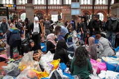 Refugees in Central Station in Copenhagen. Refugees, and people who want help with food and clothes in Central Station in Copenhagen Stock Image