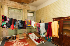 Refugees` clothes is drying of on the rope in the temporary apartment.  Royalty Free Stock Images