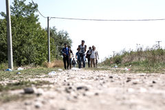 Refugees crossing the border from Serbia to Croatia in Tovarnik Stock Photos