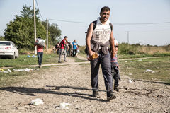Refugees crossing the border from Serbia in Tovarnik. TOVARNIK, CROATIA - SEPTEMBER 18: Refugees cross the uncontrolled border from Serbia to Croatia on Royalty Free Stock Photos