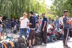 Refugees forming a waiting line in Tovarnik. TOVARNIK, CROATIA - SEPTEMBER 19: Stranded Refugees form a waiting line with luggage after their arrival from Serbia Royalty Free Stock Images