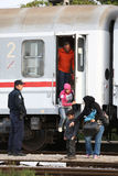 Refugees getting off train Stock Photography