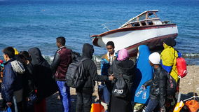 Refugees on the Greek coast, near Turkey. Refugees just arrived from Turkey on the boat to the shore of the Greek island of Lesbos. Waiting for the bus to camp royalty free stock images
