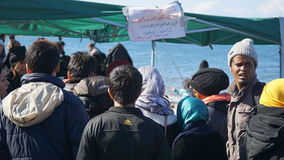 Refugees on the Greek shore. Refugees arrived from Turkey on the boat to the shore of the Greek island of Lesbos. Waiting for the bus to camp stock photography
