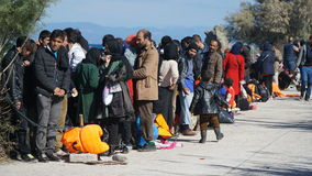 Refugees on the Greek shore Stock Images