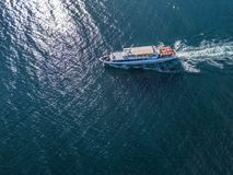 Refugees imigrants in the ferry boat ship aerial view in the sea concept d. Refugees imigrants in the ferry boat ship aerial view in the sea concept royalty free stock photos