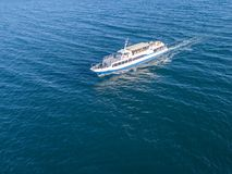 Refugees imigrants in the ferry boat ship aerial view in the sea concept d. Refugees imigrants in the ferry boat ship aerial view in the sea concept stock photo
