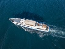 Refugees imigrants in the ferry boat ship v aerial view in the sea concept. Refugees imigrants in the ferry boat ship aerial view in the sea concept royalty free stock images