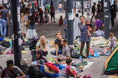 Refugees at Keleti train station. Volunteers help refugees family from Afghanistan, after seeing their story in social media. Refugees and migrants from Syria Royalty Free Stock Photo