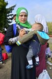 Refugees leaving Hungary. October 6,2015; Hegyeshalom in Hungary. Group of refugees leaving Hungary. They came to Hegyeshalom by train and then they leaving Royalty Free Stock Photos