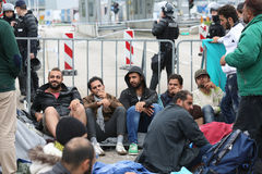 Refugees lined up on slovenian border Stock Photo