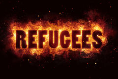 Refugees migrant text flame flames burn burning hot explosion Royalty Free Stock Photography