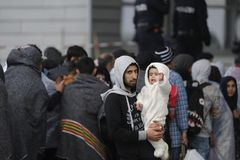 Refugees in Nickelsdorf, Austria. Image shows refugees at the Austrian border crossing Nickelsdorf in Burgenland in autumn 2015 stock photo