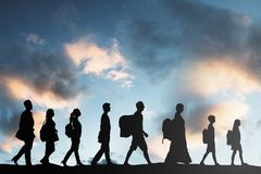 Refugees People With Luggage Walking In A Row stock photography