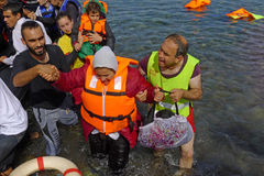 Refugees rescued from sea Lesvos Greece. Lesvos, Greece- October 12, 2015, 2015. Refugee migrants, arrived on Lesvos in inflatable dinghy boats, they stay in royalty free stock image