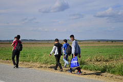 Refugees in Sid (Serbian - Croatina border). Group of Afghan refugees leaving Serbia. They came to Sid by taxi and then they leaving Serbia and go to Croatia and Royalty Free Stock Photos