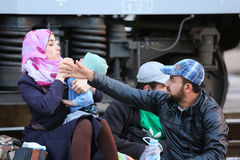 Refugees sitting on railway in Croatia Royalty Free Stock Images