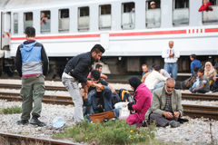 Refugees sitting on train tracks in Croatia Royalty Free Stock Image