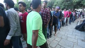 Refugees stand in a queue to receive humanitarian aid. Part are migrants from Syria stock video