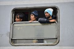 Refugees in Tovarnik (Serbian - Croatina border). October 5, 2015; Tovarnik in Croatia. Croatian police assist refugees get into train which will go to Hungary Stock Images