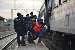 Refugees in Tovarnik (Serbian - Croatina border). October 5, 2015; Tovarnik in Croatia. Croatian police assist refugees get into train which will go to Hungary Royalty Free Stock Image