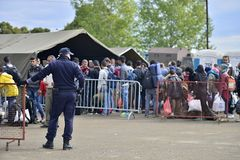 Refugees in Tovarnik (Serbian - Croatina border). October 5, 2015; Tovarnik in Croatia. Croatian police assist refugees get into train which will go to Hungary Royalty Free Stock Images