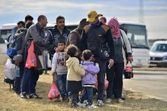 Refugees in Tovarnik (Serbian - Croatina border). October 5, 2015; Tovarnik in Croatia. Croatian police assist refugees get into train which will go to Hungary Royalty Free Stock Photography