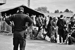 Refugees in Tovarnik (Serbian - Croatina border). October 5, 2015; Tovarnik in Croatia. Croatian police assist refugees get into train which will go to Hungary Stock Image