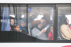 Refugees waiting in bus at border Stock Photos