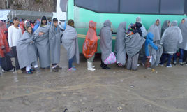 Refugees waiting in line for bus Lesvos Greece royalty free stock photos