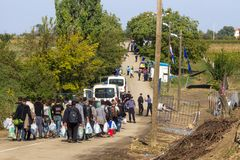 Refugees walking towards the Croatian border crossing on the Croatia Serbia border, between the cities of Bapska and Berkasovo. Picture of a groupe of groups and royalty free stock photos