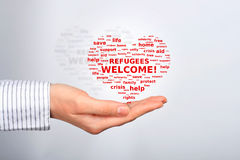 Refugees welcome. Cloud tags made in shape of hart royalty free stock photos
