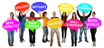Refugees welcome in different languages group of young multi eth. Nic people isolated Stock Image