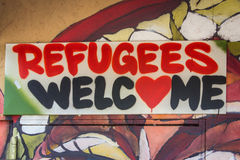 Refugees Welcome graffiti sign. Berlin, Germany , September 16, 2015: Graffiti with the political slogan Refugees Welcome, Berlin royalty free stock images