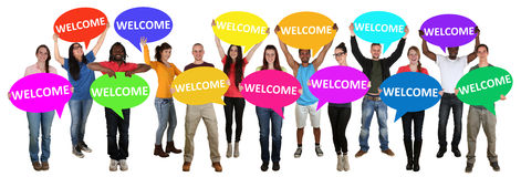 Refugees welcome group of young multi ethnic people holding spee. Ch bubbles isolated Royalty Free Stock Image