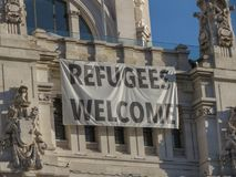 Refugees welcome message in Madrid. Refugees welcome message written on the facade of a building of the city centre in Madrid, Spain Royalty Free Stock Photo
