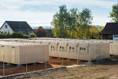 Refugees welcome. Scharnhausen, Germany - October 3, 2015: A temporary container city is set up on a former tennis ground in order to provide housing for the stock photos