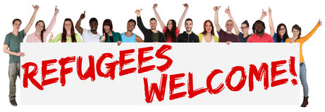 Refugees welcome sign group of young multi ethnic people. Isolated Royalty Free Stock Photos