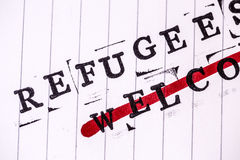 Refugees welcome strikethrough text on paper Royalty Free Stock Photography