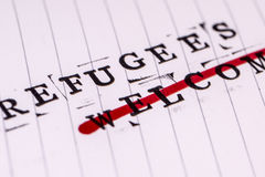 Refugees welcome strikethrough text on paper Stock Photography